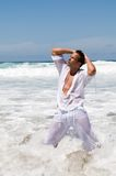 Man in the seaside wearing white clothes Stock Photos