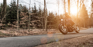 Man seat on the motorcycle on the road. Stock Photography