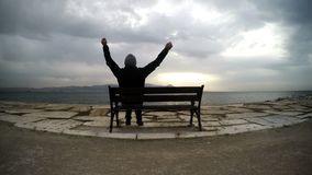 Man on a Seat near the sea. Video stock video footage