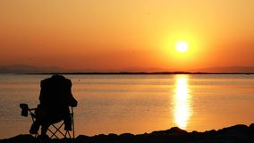 Man in Seat Watching Sunset and Sea stock video