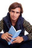 Man seated reading a book Stock Photos