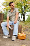 Man seated on a tree trunk Stock Photos