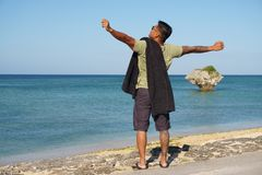 Man on vacation in Japan. Man on seawall on vacation in Japan with T shirt stretching Stock Image