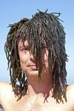 Man with seaweed Royalty Free Stock Images