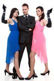Man secret agent criminal with two women gun Stock Photo