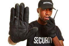 Man from security firm talking into radio set stock photography