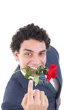 man seducer in a suit holding a red rose in his mouth with a seductive view or look royalty free stock photo