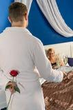 Man seducing flirting affair mistress rose bedroom Stock Photos