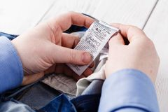 Man see washing care instruction on Jeans royalty free stock photo