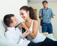 Man seeing girlfriend cheating on him Stock Photos