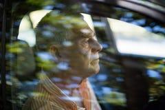 Man seen through car window Royalty Free Stock Photos