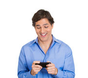 Man sees something exciting on phone Stock Image
