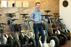 Man with segways at rental agency Royalty Free Stock Image