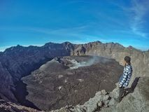 Man Seiing a Raung Crater royalty free stock images