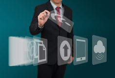 Man select computer icon on touch screen Stock Image