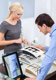Man selecting engagement ring. At jeweler's shop. Concept of wealth and luxurious life Stock Photo