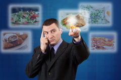 Man selecting images Royalty Free Stock Photo