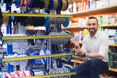 Man selecting metallic chain in household store Royalty Free Stock Photography