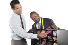 Man selecting neckties with tailor standing besides Stock Photography
