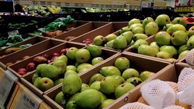 Man selecting pear in grocery store stock video footage
