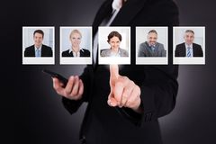 Man selecting a profile picture royalty free stock photo