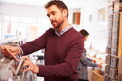 Man selecting records at record shop Royalty Free Stock Image