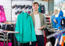 Man selecting a warm sport jacket Stock Images