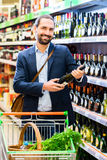 Man selecting wine in store Stock Photography