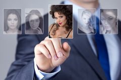 Man selecting a woman portrait image. Business men selecting a women portrait image Royalty Free Stock Photo