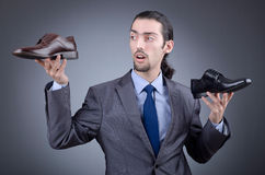 Man with a selection of shoes Stock Images