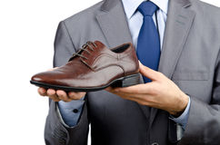 Man with a selection of shoes Stock Photos