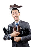 Man with a selection of shoes Royalty Free Stock Photos