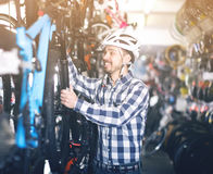 Man selects bicycle Royalty Free Stock Photography