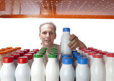 The man selects dairy products in the shop.  Royalty Free Stock Photography