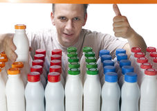 The man selects dairy products in the shop.  Stock Photography