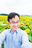 Man selfie happily with sunflower Stock Photos