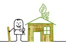 Man & Selfmade Wood House Stock Photo