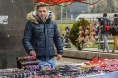 Man sell souvenirs Stock Photos