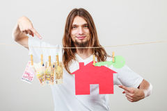 Man seller with money and house Royalty Free Stock Photography