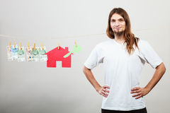 Man seller with money and house Stock Photos