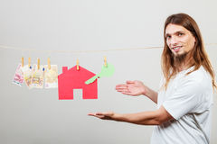 Man seller with money and house Stock Photography