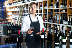 Man seller wearing uniform holding glass of wine Royalty Free Stock Images