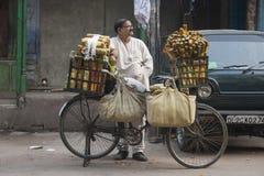 Man selling aromas Stock Images