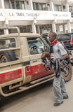 Man selling belts. On the streets of Tanzania,It´s a vertical picture taken in May 2014 Royalty Free Stock Photo