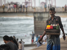 Man selling betel leaf. Pann or betel leaf seller at Gall face, Sri Lanka. preparation is done combining betel leaf with areca nut and sometimes also with Stock Image