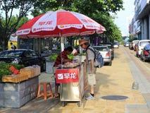 Man selling breakfast on the roadside Stock Photos