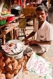 Man selling coconuts in Kathmandu, Nepal Royalty Free Stock Photo