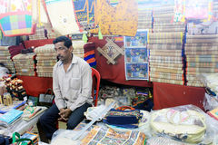 A man is selling colorful handcraft made by jute. Stock Image