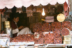 Man selling dates on the market of old Sana Stock Images
