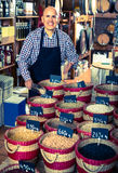 Man selling dried beans Royalty Free Stock Photo